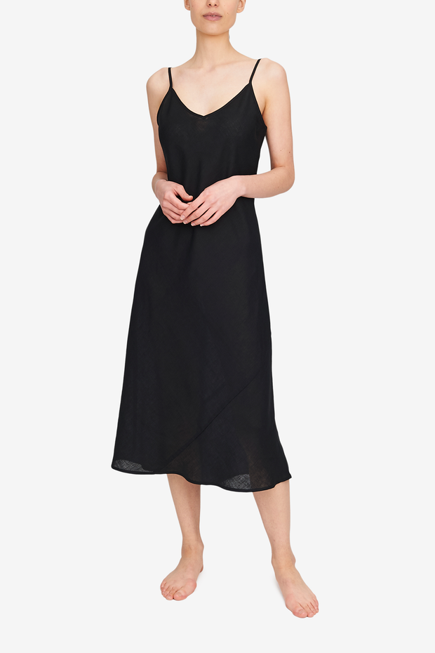 Midi length skip dress made in black linen. Adjustable spaghetti straps, v-neck, cut on the bias for the ultimate fit.