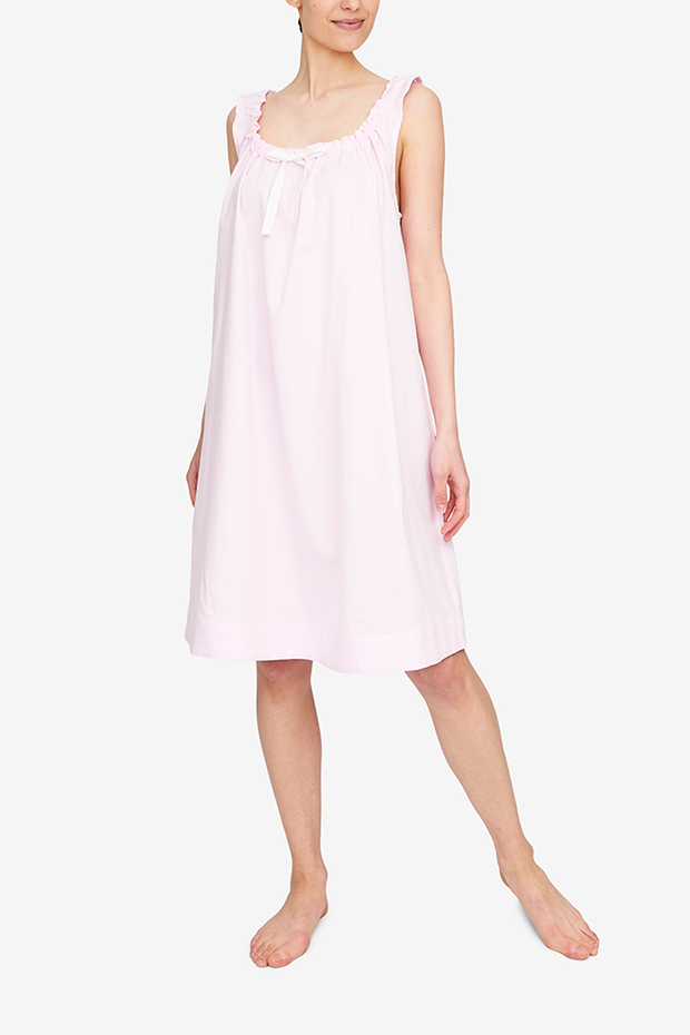 Front view of the knee-length Sleeveless Nightie with a gathered neclkline. The light pink royal oxford cotton is lightweight and hangs beautifully.
