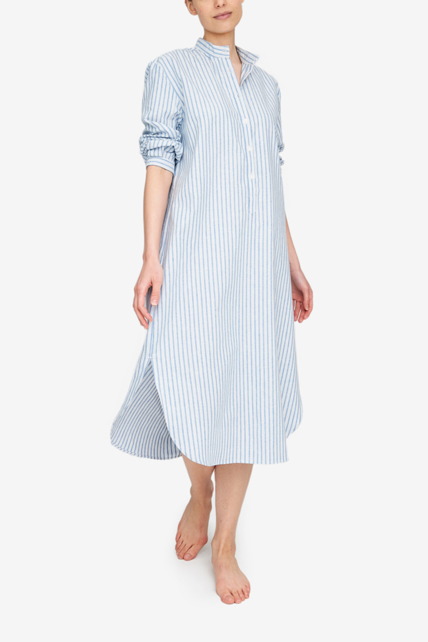 A long, slim nightshirt with three quarter sleeve and a stand collar. It's made in a luxuriously soft cotton linen blend with a vertical blue and white stripe.