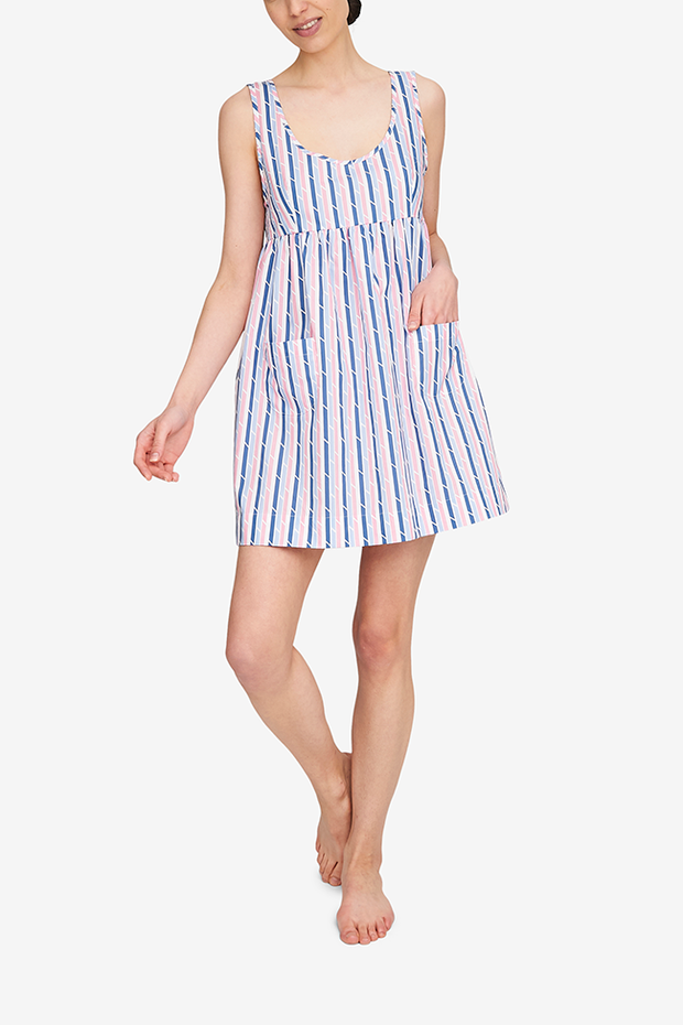 The Pocket nightie, shown here in the Blue & Pink Trio Stripe, has a high empire waist, a tank-style bodice and a gathered skirt with two patch pocket on the front. It's on the shorter side, hitting most about mid-thigh.