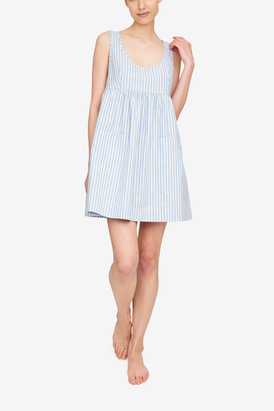 The Pocket nightie, shown here in our blue and white striped Sapporo cotton linen blend, has a high empire waist, a tank-style bodice and a gathered skirt with two patch pocket on the front. It's on the shorter side, hitting most about mid-thigh.