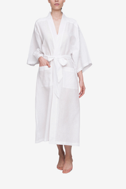 Front view of full length white linen robe with belt by The Sleep Shirt