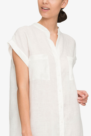 front cropped view knee length button down tshirt with pockets in white linen by the Sleep Shirt