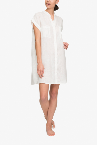 front view knee length button down tshirt with pockets in white linen by the Sleep Shirt