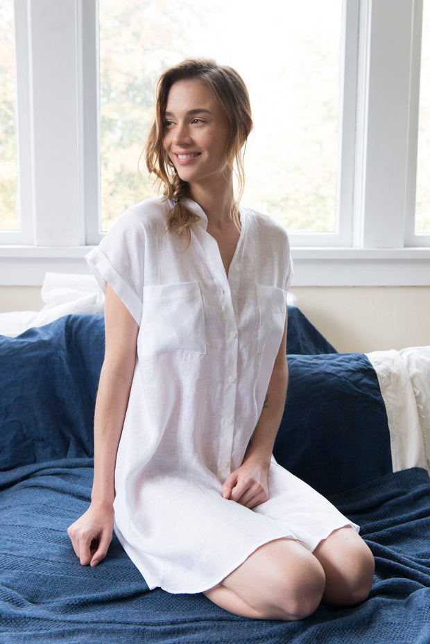 knee length button down tshirt with pockets in white linen on model by the Sleep Shirt