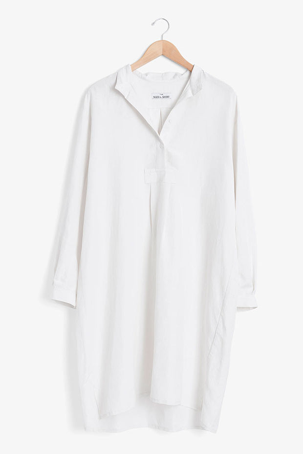 A white nightshirt on a hanger, made by a sleepwear company that specialises in nightgowns for older ladies.