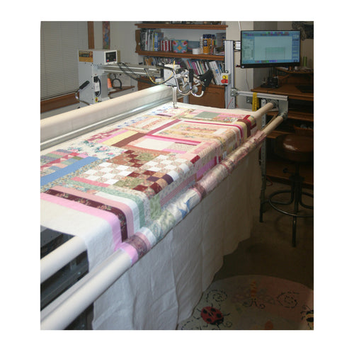 Our quilting is done on an Innova Mach3 Computerized Longarm on a 12' frame to handle most any quilt size.  At this time we are offering Edge to Edge quilting as well as Edge to Edge with a border.  Prices start at just $0.015 per square inch.  Call today to schedule the pick-up/drop off your quilt.  509-981-1858