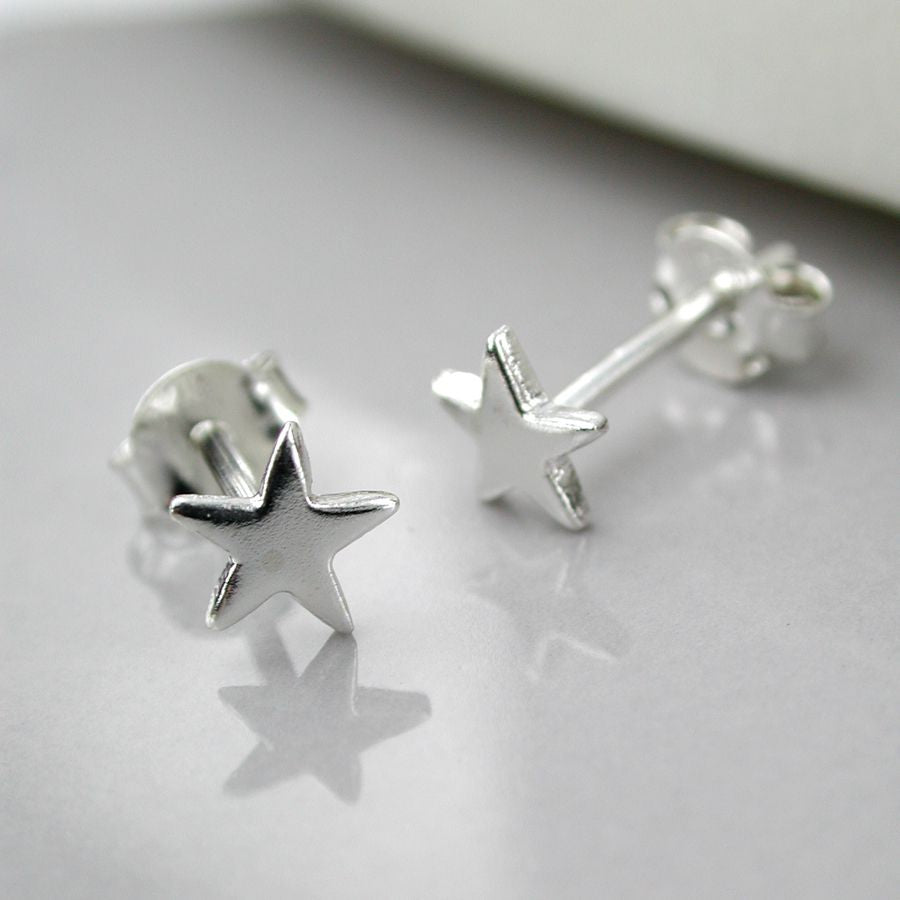 Tiny sterling silver star studs