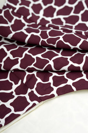 Detail of bikini in dark red burgundy giraffe animal print by Caroline af Rosenborg