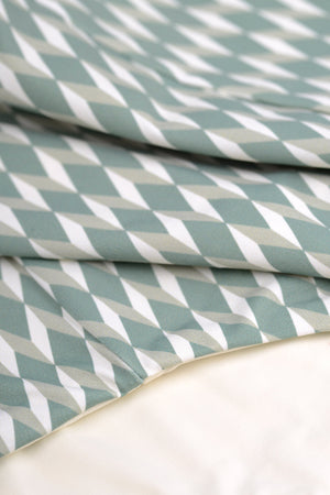 Detail of sage green  bikini in geometric tile print by Caroline af Rosenborg