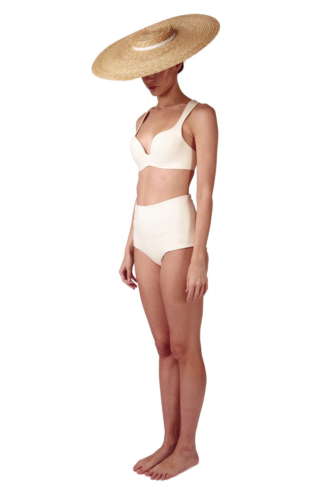 White high waisted bikini bottoms in ivory cream it is reversible with a retro look by Caroline af Rosenborg
