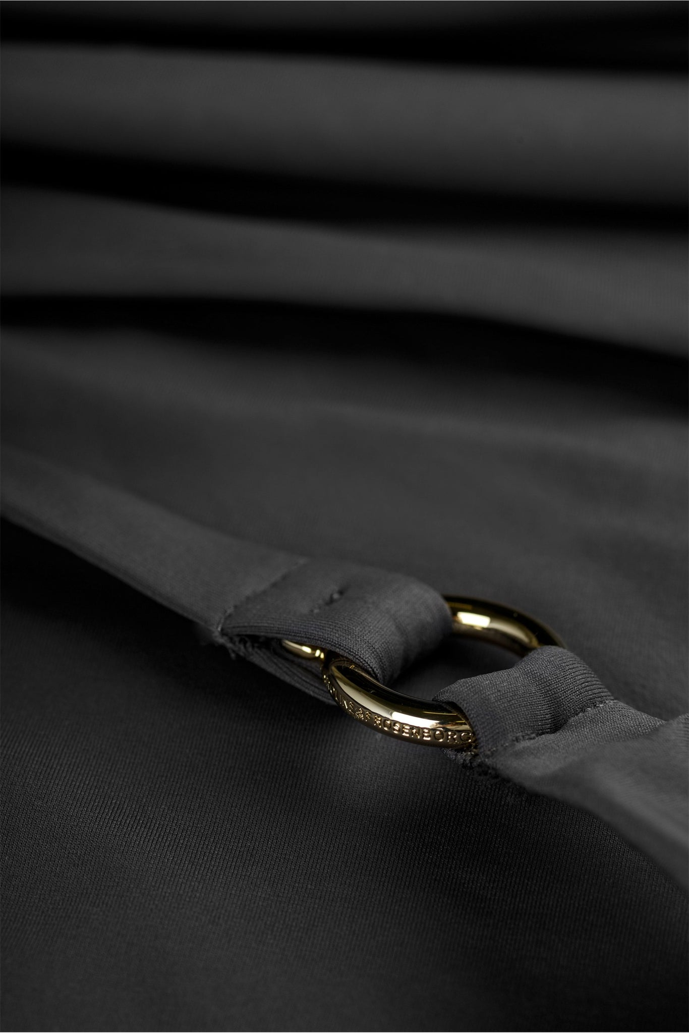 Detail of swimsuit in grey black charcoal with deep cross back by Caroline af Rosenborg