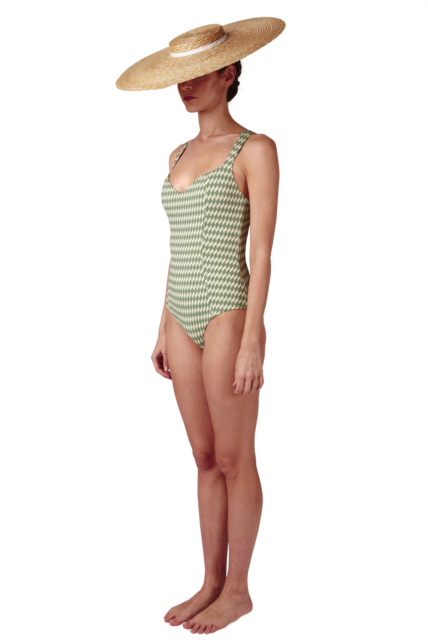 Sweetheart neckline green swimsuit with cream white geometric diamond print with deep cross back by Caroline af Rosenborg