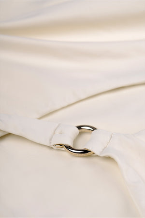 Detail of swimsuit in cream white with deep cross back by Caroline af Rosenborg