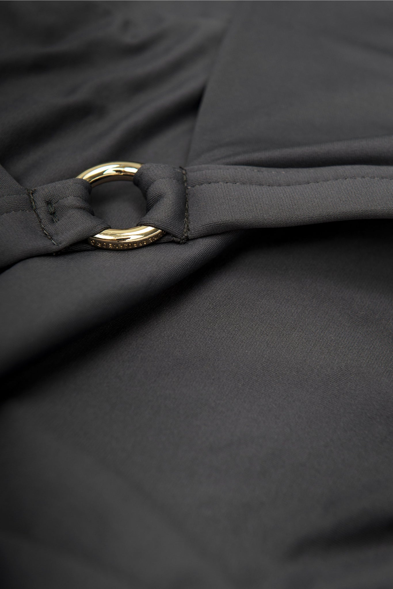 Front detail of front opening halter neck bikini top in grey black charcoal by Caroline af Rosenborg