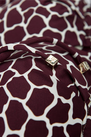 Detail of front tie triangle top in burgundy red giraffe print by Caroline af Rosenborg