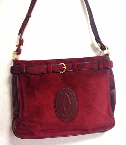 Vintage Cartier wine suede leather shoulder bag with a decorative built-in belt. les must de cartier collection.