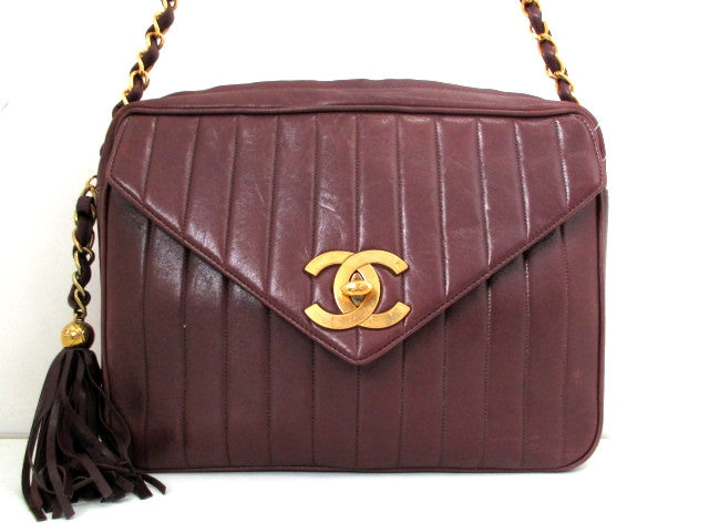 SOLD OUT: Vintage CHANEL CC flap, large brown lambskin chain shoulder bag with vertical stitches and a matching fringe. Classic jumbo 2.55 bag. Rare masterpiece