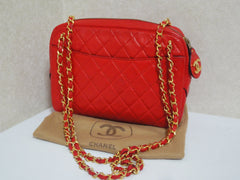 80's Vintage CHANEL red lambskin classic shoulder purse with double gold tone chain straps and a CC pull charm.