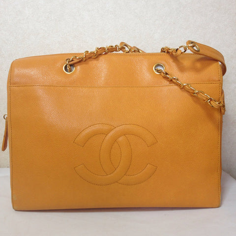 Vintage CHANEL orange yellow color caviar leather chain shoulder large tote bag with gold-tone chain handles and large CC stitch mark. Lucky