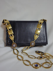 MINT. Vintage Gianni Versace navy leather clutch shoulder purse with snake skin and golden parts and crystal, blue, and red jewel stones.