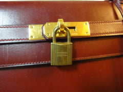 1980s Vintage HERMES Kelly 32 bag rouge ash box calf leather with gold hardware. Exterior stitch. Stamp K in O, 1981. Best known classic bag