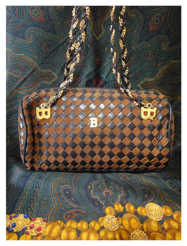 Vintage Bally brown bronze quilted leather tote bag with chain straps and a matching tassel to the zipper. Golden B logo motif.