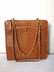 MINT. Vintage CHANEL camel brown caviar leather square shoulder tote bag with golden chain straps and CC closure. Classic bag