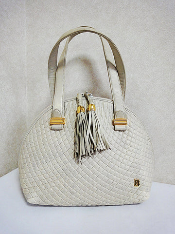 SOLD OUT: Vintage BALLY ivory white quilted lambskin mini tote bag with golden B charm and double tassel zipper.