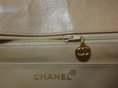 Vintage Chanel classic beige caviar leather 2.55 square shape chain shoulder bag with golden CC closure. Must have purse.