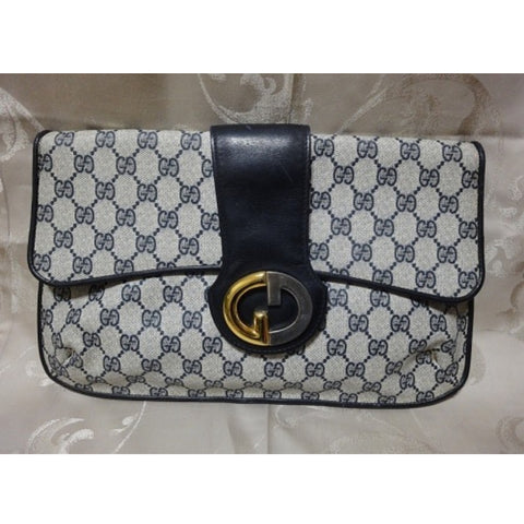 SOLD OUT: 80s Vintage Gucci navy monogram and GG charm clutch purse. Rare unique shape Gucci bag.