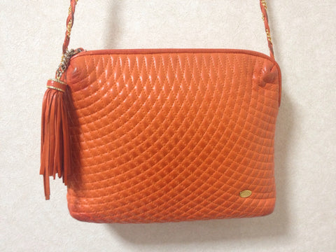 Vintage BALLY rare color, orange quilted lambskin golden chain shoulder purse with golden motif and matching tassel.
