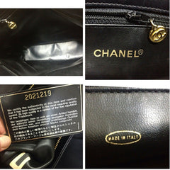 Vintage CHANEL black classic tote bag in nappa leather with gold tone CC charm and large CC mark. Perfect daily purse