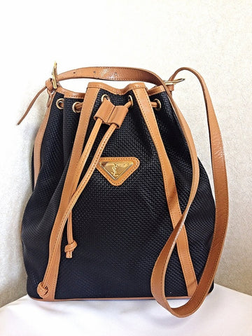 Vintage Yves Saint Laurent  black hobo bucket shoulder bag with brown leather trimmings and golden logo plate. YSL classic unisex purse.