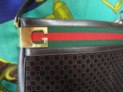 Vintage Gucci dark brown suede GG print shoulder bag with sherry line webbing, green and red. Rare masterpiece purse