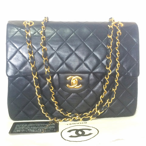 Reserved for tl. 80's vintage CHANEL black lambskin classic 2.55 double flap shoulder purse with gold tone chain straps. Best bag to own for life.