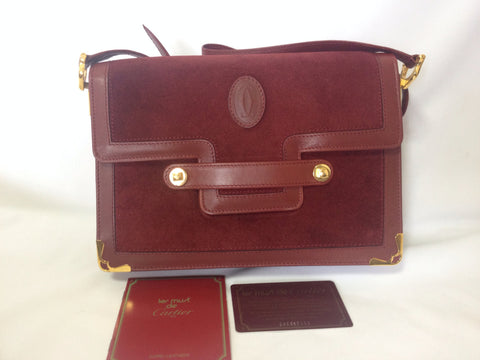 Vintage Cartier document envelope style wine suede leather shoulder purse with logo applique. les must de cartier collection.