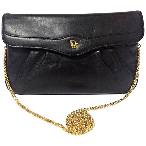 Vintage Christian Dior Vintage black leather clutch purse, mini bag, with golden Dior motif and gold tone chains.