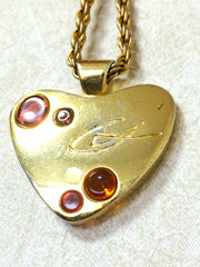Vintage Christian Lacroix golden heart chain long necklace with pink and orange stones and embossed logo. Perfect gift jewelry.