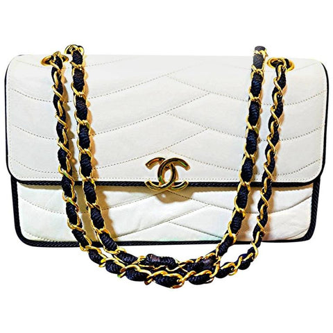 MINT. 80's rare vintage Chanel white 2.55 flap bag with navy rope string and gold chain.  Very rare purse from the era.