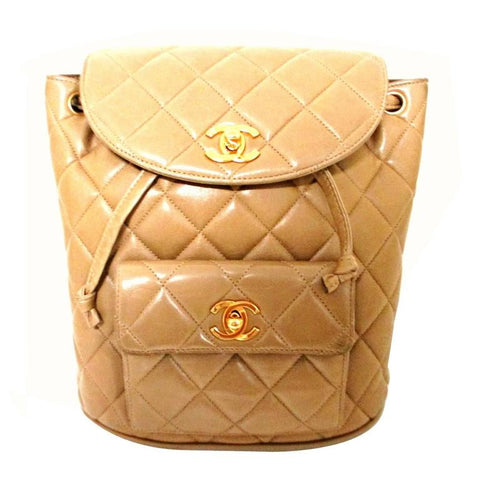 Vintage CHANEL quilted brown beige lamb leather backpack with gold chain strap and CC closure. Classic and popular bag rare