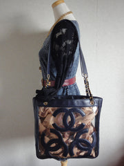 Vintage CHANEL clear vinyl and navy leather combination shoulder purse, tote with CC marks and matching pouch. Golden chain.