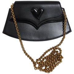 MINT. Vintage Christian Lacroix black leather pointy flap tip and heart motif, party clutch purse with golden chain strap. Hot masterpiece