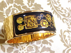 SOLD OUT: Vintage Hermes cloisonne enamel yellow, green, orange, pomegranate, flower, and leaves design motif golden click and clack Flacon bangle.