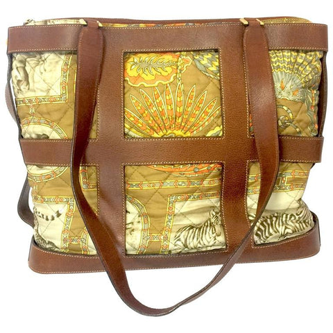 Vintage Salvatore Ferragamo quilted silk fabric bag with brown leather frame and straps. Feather, zebra, tropical safari design in khaki.