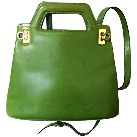 Vintage Salvatore Ferragamo green leather golden gancini trapezoid shape handbag with shoulder strap.