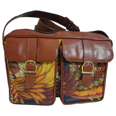 Vintage Salvatore Ferragamo tropical and feather safari pattern messenger shoulder bag with brown leather trimming. Exotic design. Unisex