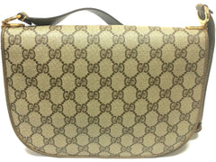 Vintage Gucci brown and beige monogram shoulder purse with golden and silver tone GG motif closure hock with brown leather strap. Rare bag