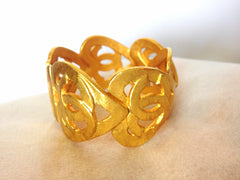 Vintage CHANEL rare heart shape with CC rayred design bangle bracelet. One of a kind jewelry piece.