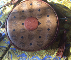 Vintage MCM rare brown monogram round shape shoulder bag with brown leather trimmings. Designed by Michael Cromer. Masterpiece. Unisex use.